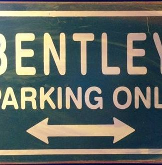 BENTLEY PARKING ONLY RUSTY TIN SIGN