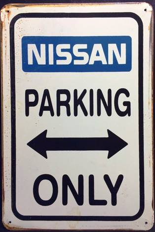 NISSAN PARKING ONLY RUSTY TIN SIGN