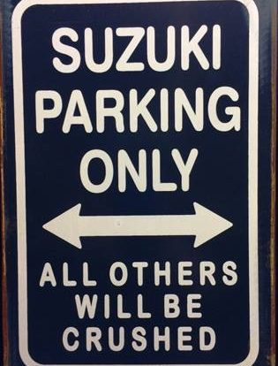 SUZUKI PARKING RUSTY TIN SIGN